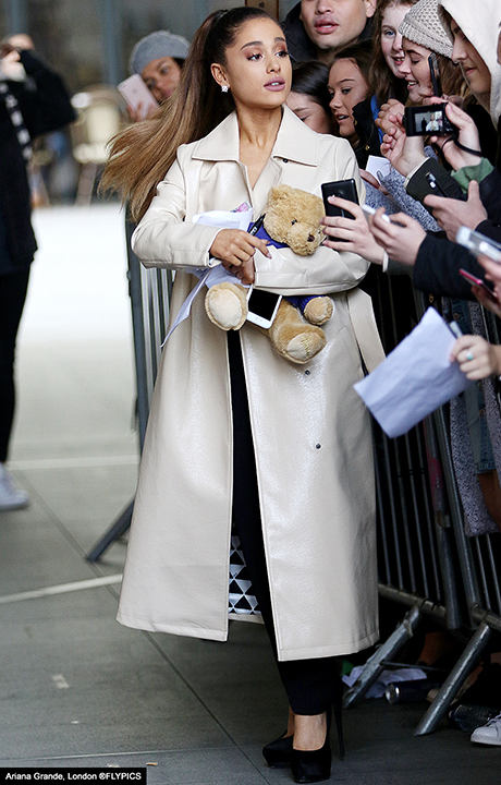 Ariana Grande rocks trendy trench coat to radio